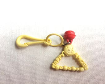 bell charm, plastic charm necklace 80s, vintage, retro, eighties, yellow, angel, happy