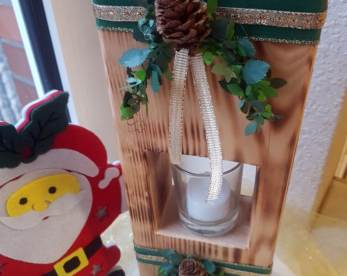 Christmas decoration wooden block with candle in glass wood