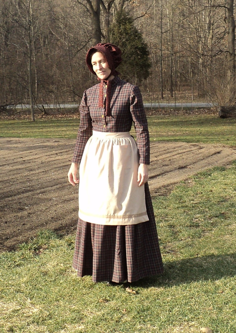 Victorian Edwardian Apron, Maid Costume & Patterns Womens old fashioned Tea-dyed cotton apron pioneer wild west Civil Colonial Revolutionary War Victorian maid costumes READY-TO-SHIP $1,750.00 AT vintagedancer.com
