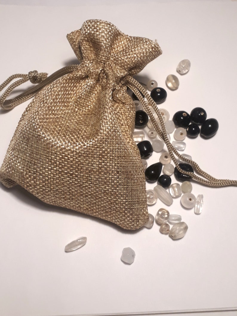 sizes designs hand made in India fairtrade in hesian gift bag ready gift A bagful of beads black and white glass beads mixed shapes