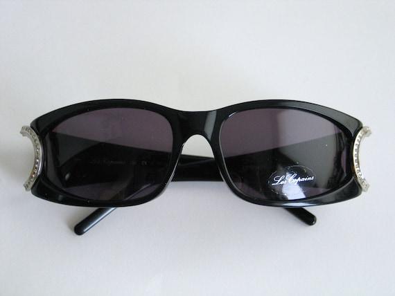seleziona per autentico goditi il miglior prezzo stili diversi Les Copains nero occhiali da sole realizzati negli anni 90 in Italia.
