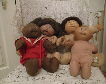 4 Cabbage Patch dolls with huge lot of baby cloths