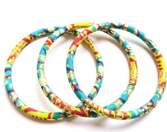 African wax bracelets assorted in a set of 3 ethnic bangles in Ankara print turquoise/anise/red/gold