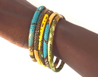 Gold wax bracelets in a set of 3 turquoise/khaki/yellow/gold African stackable bangles, available in 2 sizes