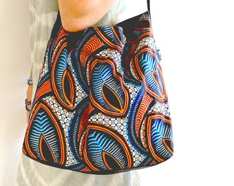 African ankara print bag with recycled leather handles and bottom, turquoise/orange graphic print