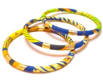Golden Ankara bracelets for women, fine ethnic bangles in two sizes with Ankara fabrics gold/navy/orange/green