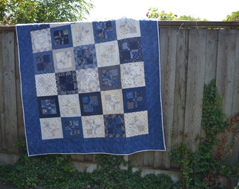 Blue and white bed quilt