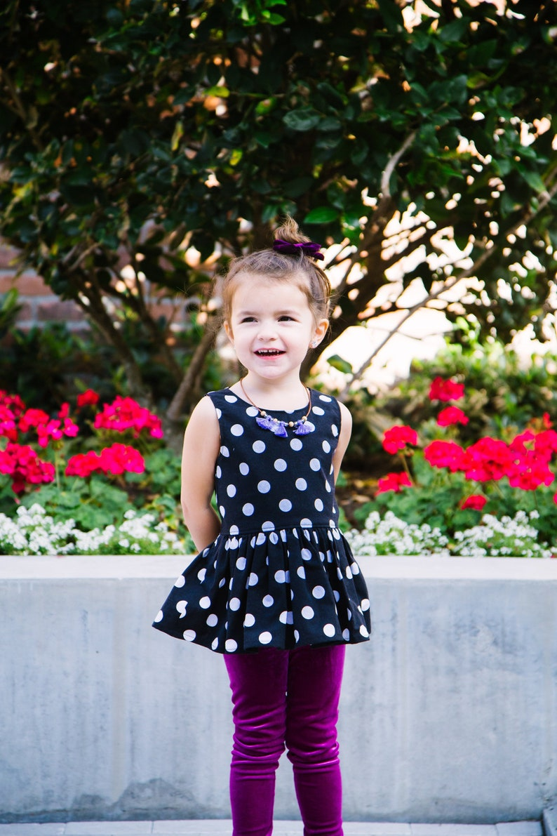 ed045f705c4 Black and White Polka Dot Peplum Top for Little Girls Little