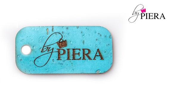 cork tags, bag making tags, cork hanging tags, laser etched tags, laser etched cork tags, custom logo hang tag