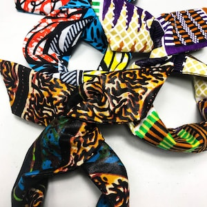 3 little darlings with African wax buns wrap inner wire bun