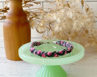 Pink and black braided cotton bracelet with lobster claw clasp
