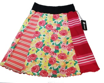 T-Skirt -'Summer Flowers in Pink , Orange & Red' , Size Medium.   A fun and casual skirt that's easy to wear and easy to care.