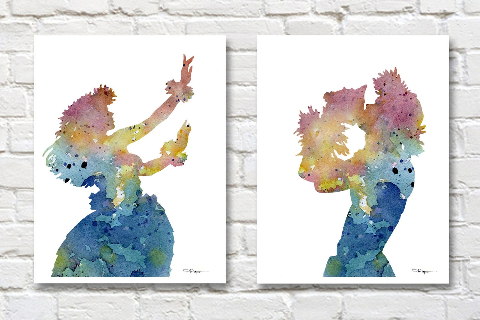 Wall art of hula girl dancer and male dancer