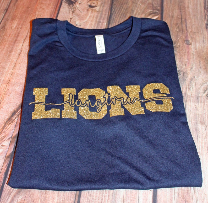 29ae72dc08ade LANGTREE SPIRITWEAR #180 Navy S/S Shirt with Gold Glitter