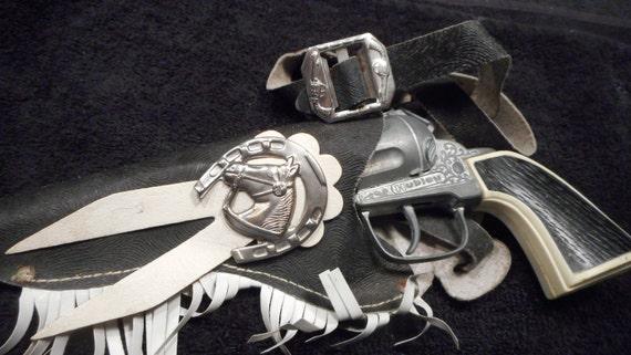 1960's Hubley die cast repeater in single holster. Mattel,actoy,marx,nichols,kilgore,halco, cap gun,cap guns, western toy