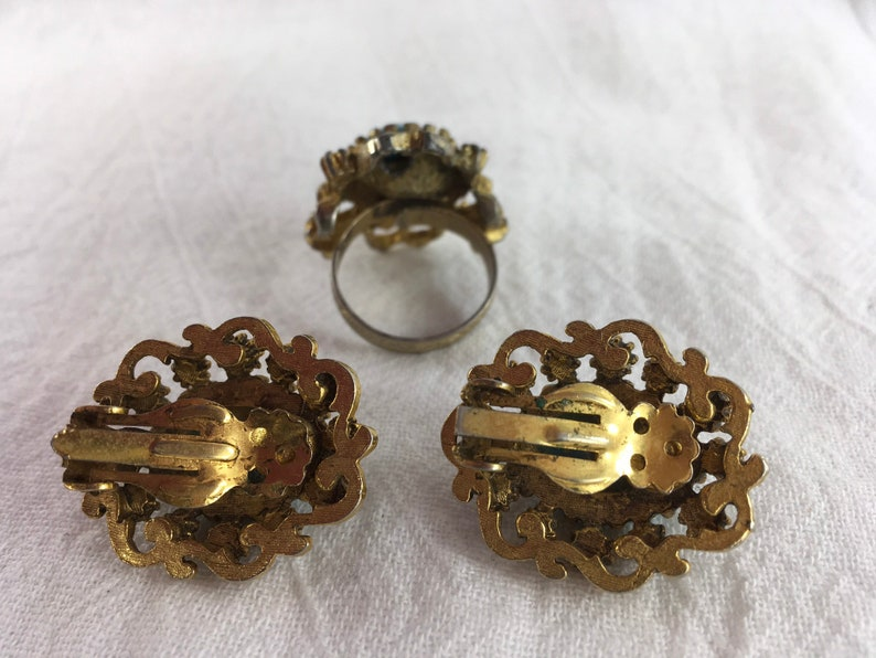 Stunning adjustable vintage ring and clip earring set!