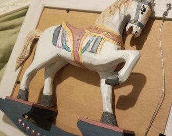 Vintage hand carved wooden rocking horse, one leg up