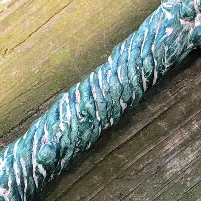 Green and White Handled Wand with Black Skull