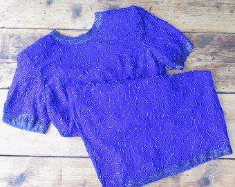 Vintage blue dress with beaded embellishment