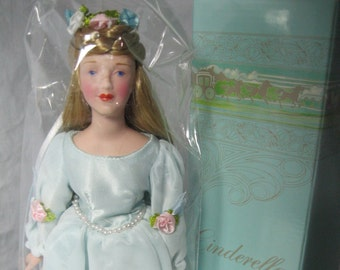 Porcelain Cinderella Doll  - Avon Fairy Tale Collection - NIB with stand.