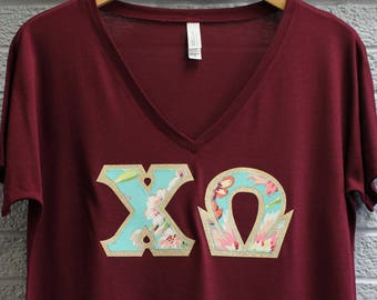 Chi Omega Maroon Bella Flowy V-Neck With Amy Butler Bliss Bouquet on Gold Metallic (254C)