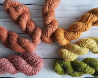 Plant dyed wool yarn. 50g / 75m skein. Single breed.