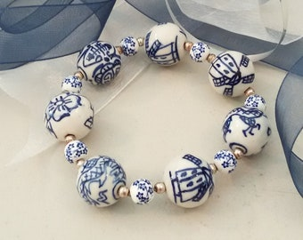 Danish blue bracelet, white porcelain beads with windmills, tiny floral spacers and sterling silver spacer make up this stretch bracelet