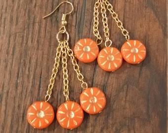 German Orange & gold glass disc earrings on chains