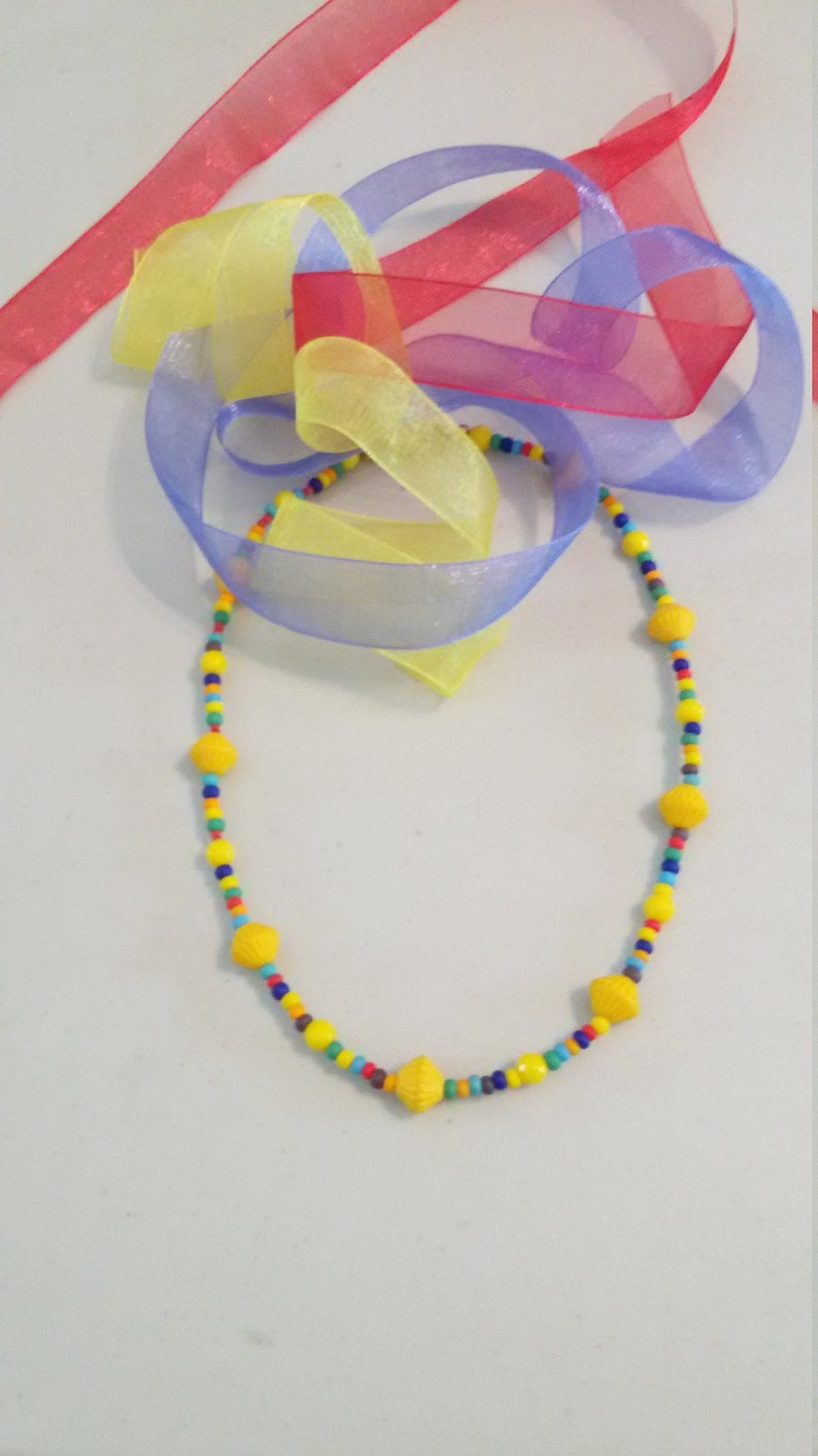 Sunshine yellow choker A delightful blend of comfort and simplicity; this choker ranks high in summer fun.