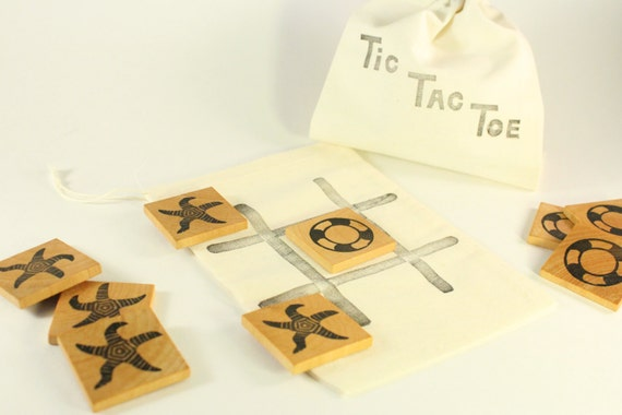 Mini Tic Tac Toe game with little canvas bag.