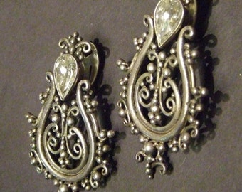 Large Vintage sterling post earrings with rhinestones and hinged to allow movement.  1.75 inch.