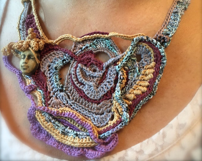 Featured listing image: Here's Looking at you....Free form crochet necklace with handmade clay face.