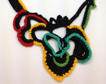 Curvy colors on black will fit in anywhere and anytime with this highly versatile hand crocheted necklace.