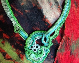Elegant, one of a kind crochet statement necklace…and all in one unique conversation piece around your neck!