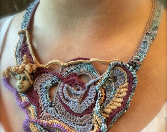 Here's Looking at you....Free form crochet necklace with handmade clay face.