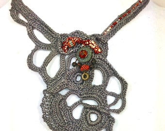 Hand crochet statement necklace in a soft steel grey.  This unique necklace is beautiful with silver and dark hair