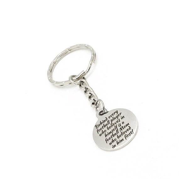 Football Mom Gift, Football Mom Keychain, Behind Every Football Player That Believes In Himself Is A Football Mom That Believed First
