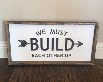 We must build eachother up sign