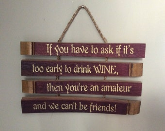 Multiple wine stave signs with fun sayings.  Two separate sayings; one on three staves and one on four staves.