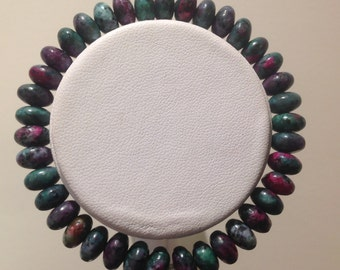 Bracelet. 18cm.  Features 8mm China Zoisite 8mm rondelle Gemstone beads