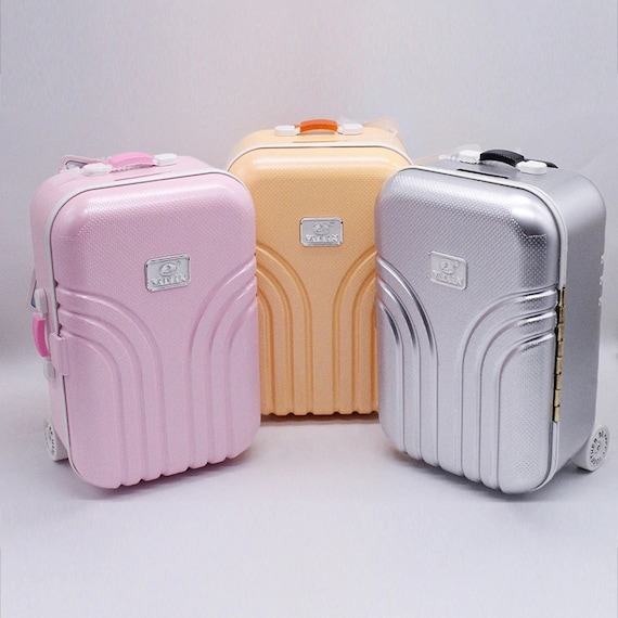 Suitcases for dolls like the American Girl or Wellie Wisher. Also is a Bank
