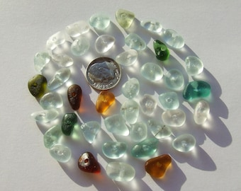 40++ small fragments of authentic sea glass, perforated in the center (hole about 1mm), for jewelery work 2038
