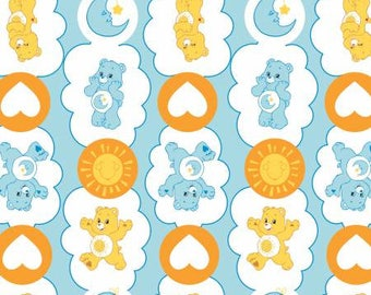 Camelot Fabric - Licensed Care Bears - Funshine Bear & Bedtime Bear on Blue Cotton Flannel Fabric