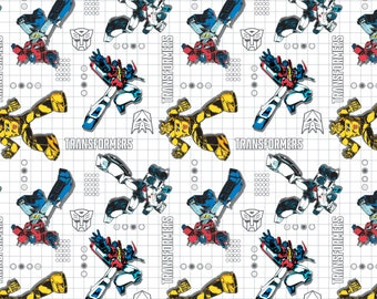 Camelot Fabrics - Licensed Transformers - Poses on Grid White Cotton Woven Fabric