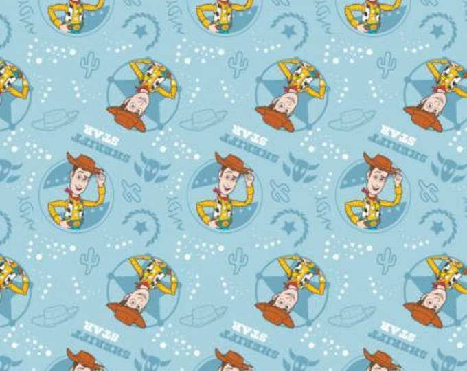 Toy Story Woody on Light Blue Cotton Woven