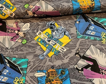 CLEARANCE -       Dr. Who Madman on Gray Cotton Woven - Priced by the Yard