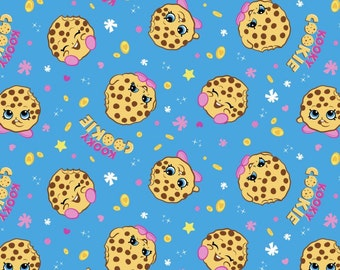 Springs Creative - Kookie Cookie on Blue Cotton Lycra Knit Fabric