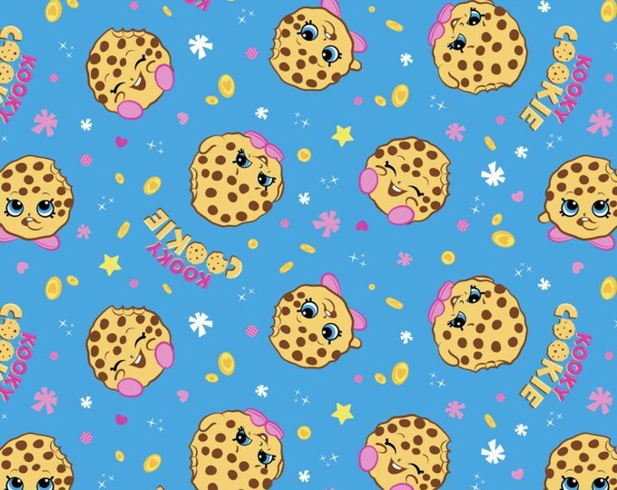 Kookie Cookie on Blue Cotton Lycra Knit Fabric by Springs Creative