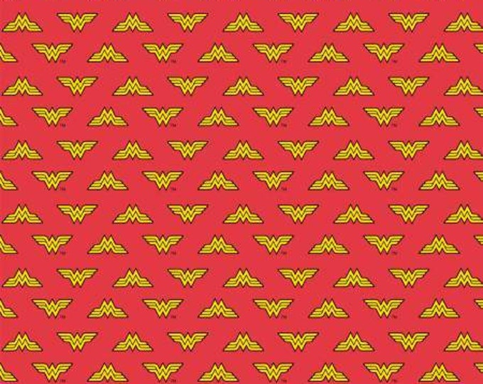 DC Comics, Wonder Woman Logo on Red Cotton Woven fabric by Camelot Fabrics
