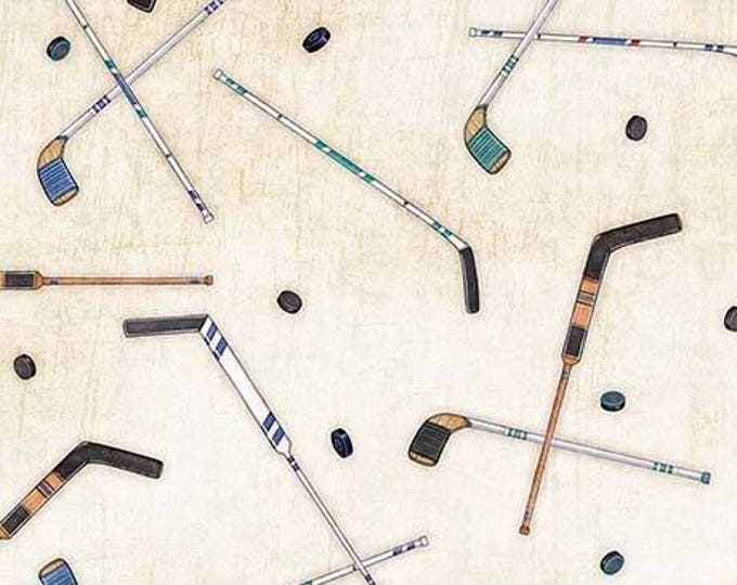 Face Off Hockey, Hockey Sticks and Pucks cotton woven fabric by Dan Morris